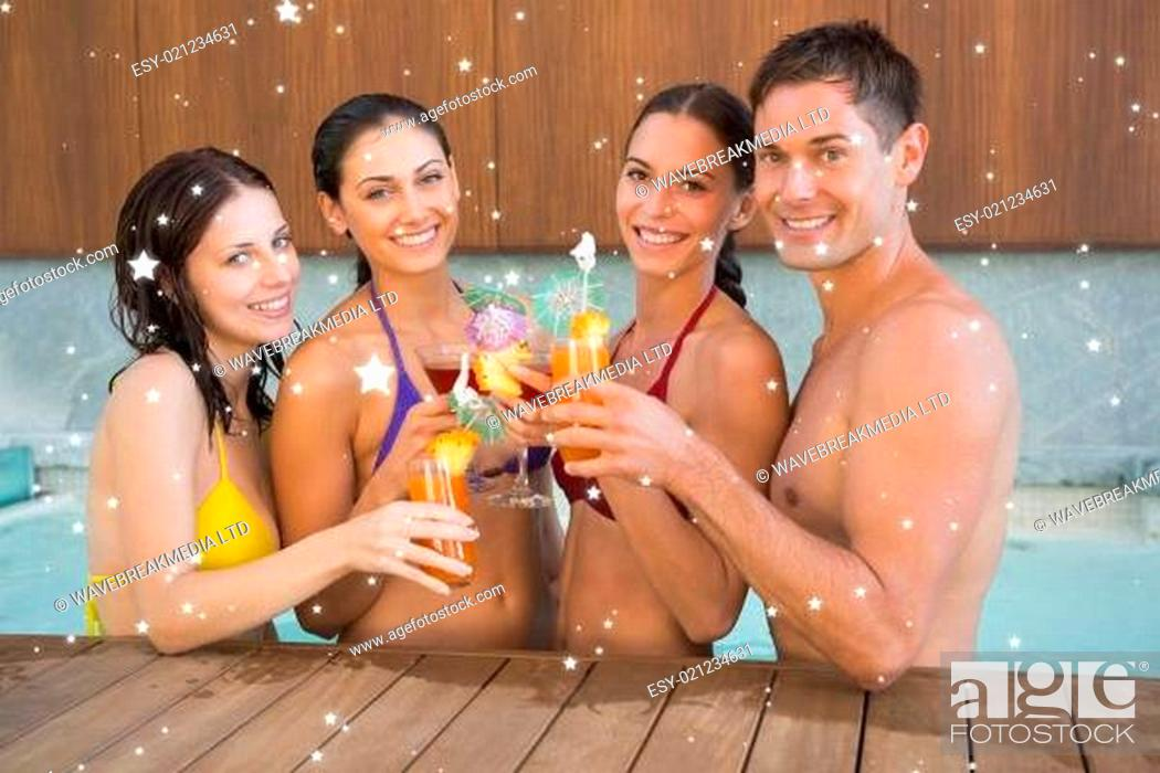 Stock Photo: Cheerful people toasting drinks in the swimming pool.