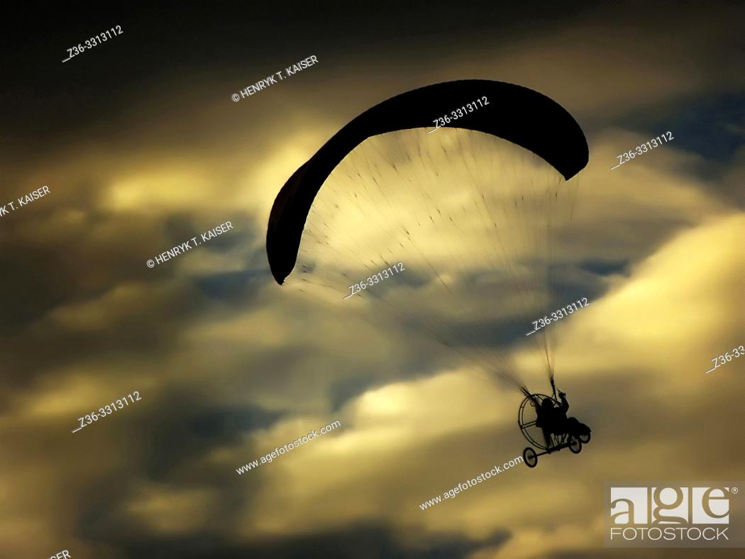 Stock Photo: Paraglider over cloudy sky, Poland.