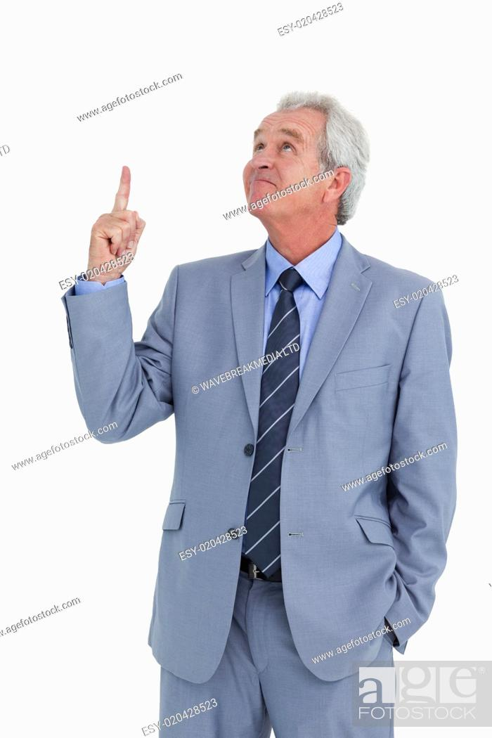 Stock Photo: Mature tradesman pointing and looking up.