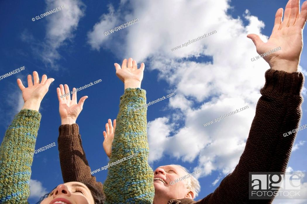 Stock Photo: Close-up of a couple with their arms raised.
