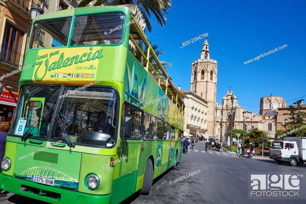 Stock Photo: Tourist bus. «Micalet« belfry and cathedral. Plaza de la Reina. Valencia. Comunidad Valenciana. Spain.