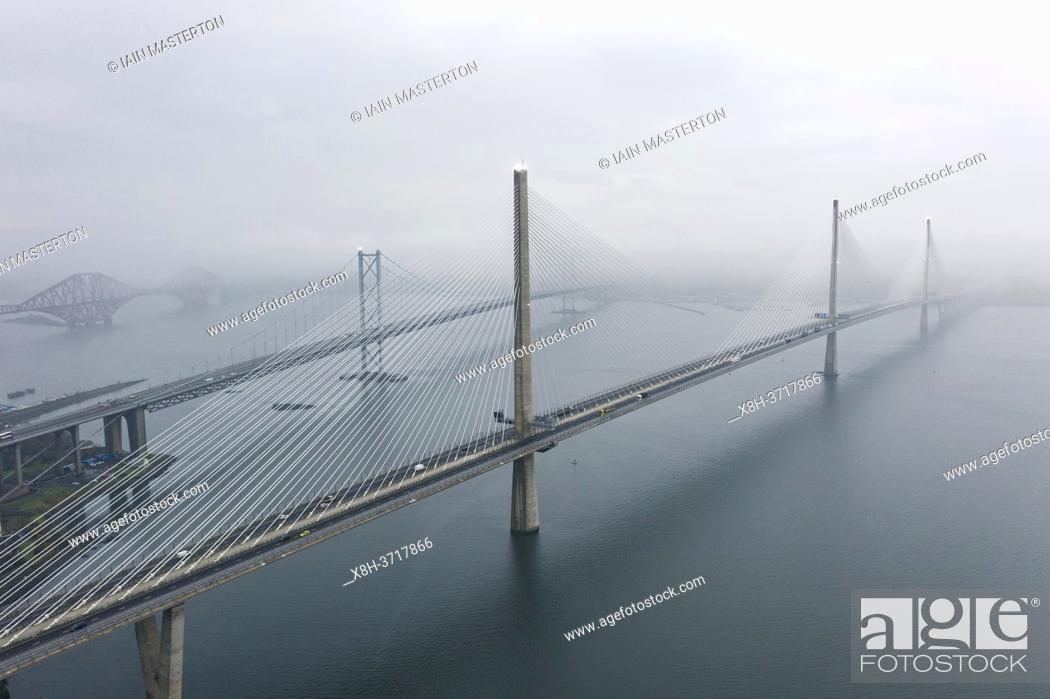 Stock Photo: Aerial view of the three bridges crossing Firth of Forth during fog, Scotland, UK.
