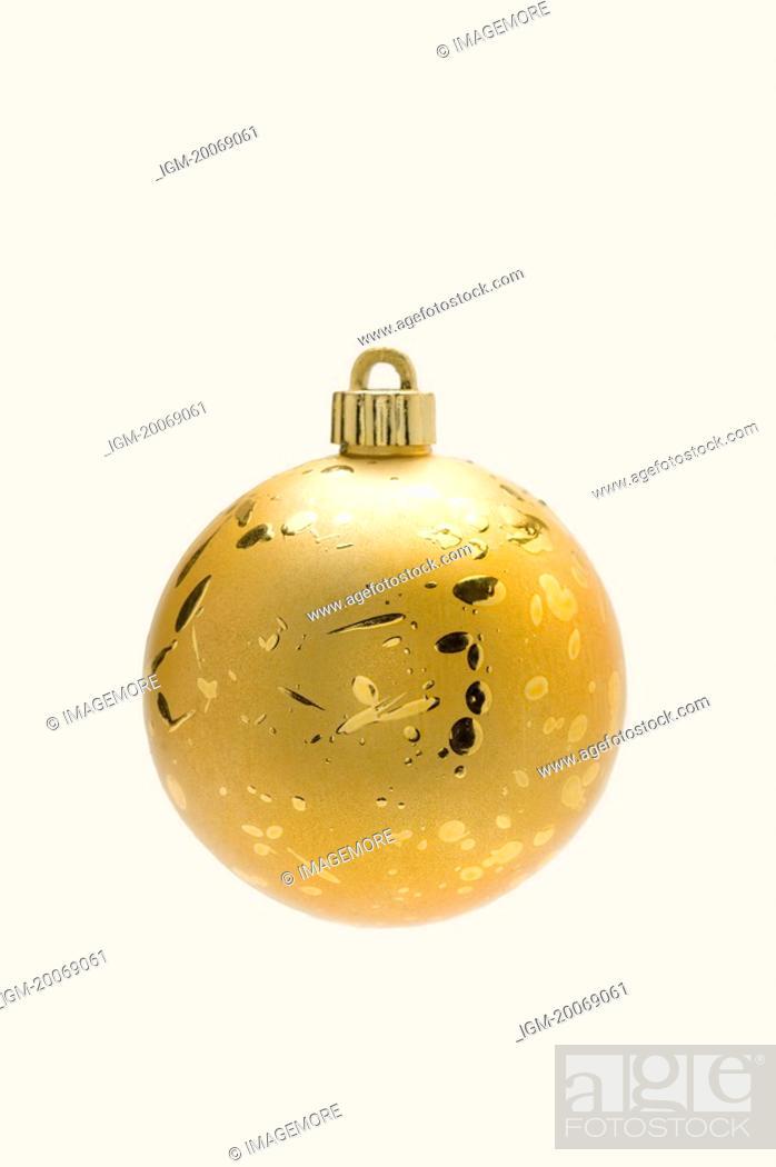 Stock Photo: A golden Christmas bauble.