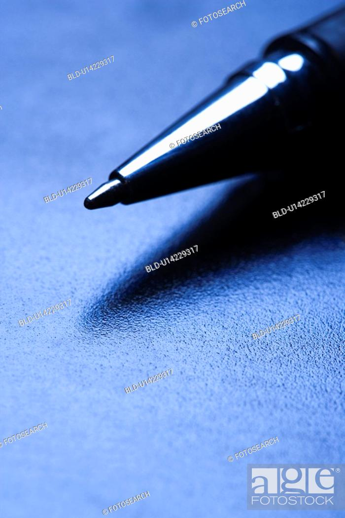 Stock Photo: Blue tone close-up of pen tip.