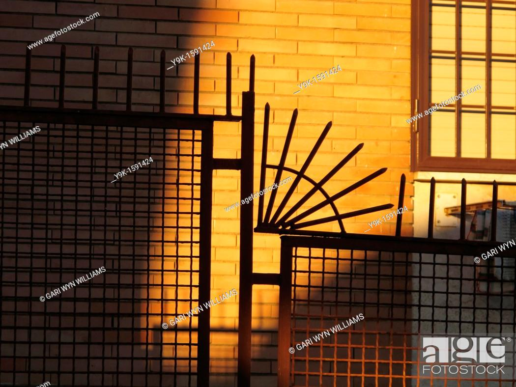 Stock Photo: Fence by property in Italy.