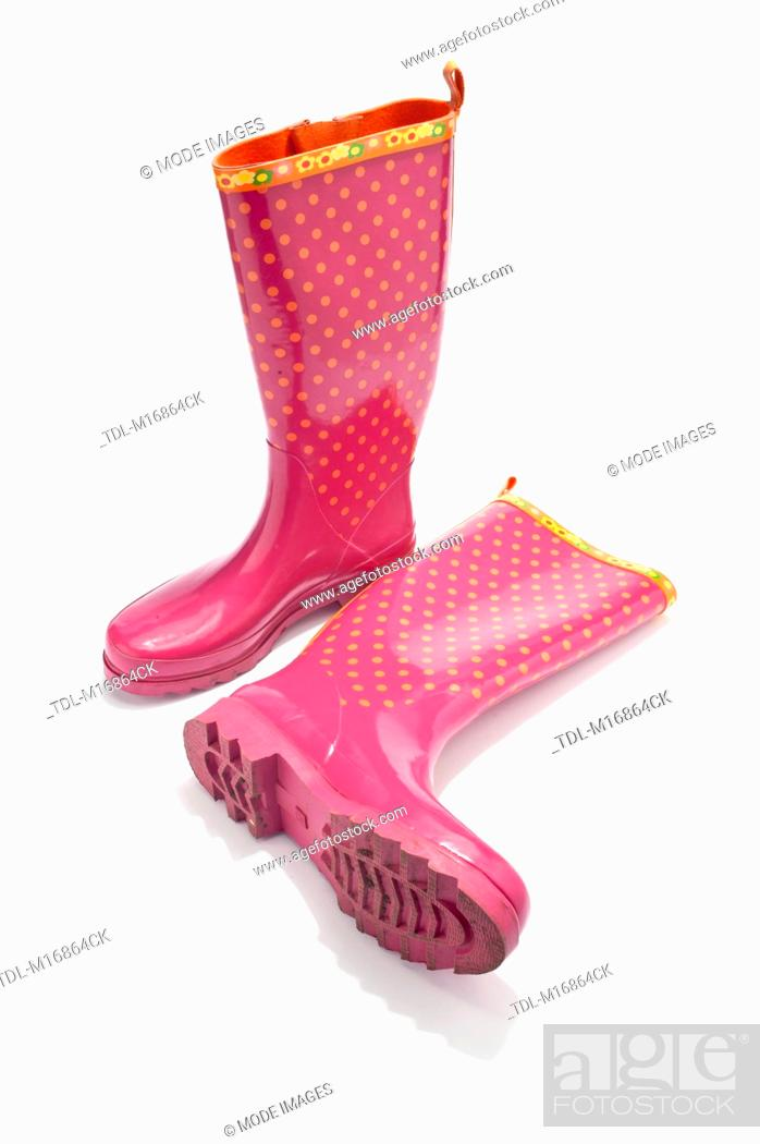 Stock Photo: A pair of pink and orange Wellington boots.