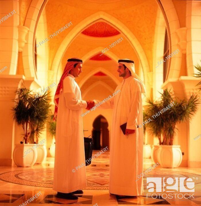 Stock Photo: Handshake between Arab businessmen.