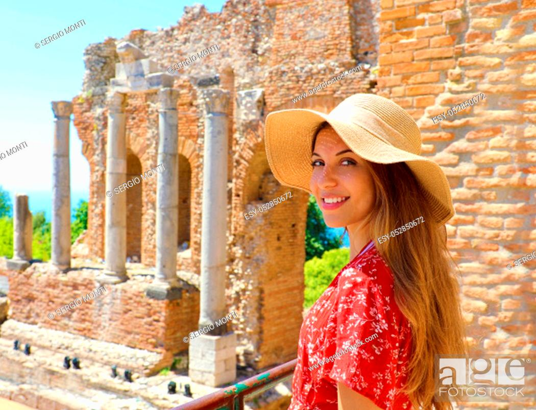 Stock Photo: Portrait of young smiling woman with hat in famous Taormina Greek Theatre, Sicily, Italy.