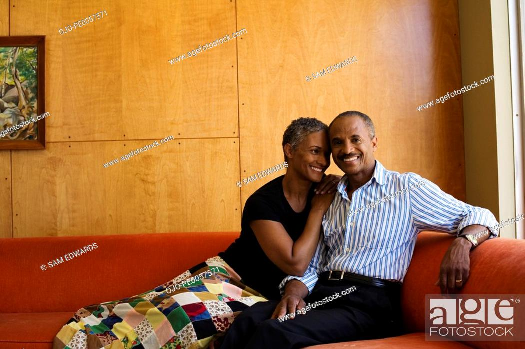 Stock Photo: Couple on sofa in modern home.