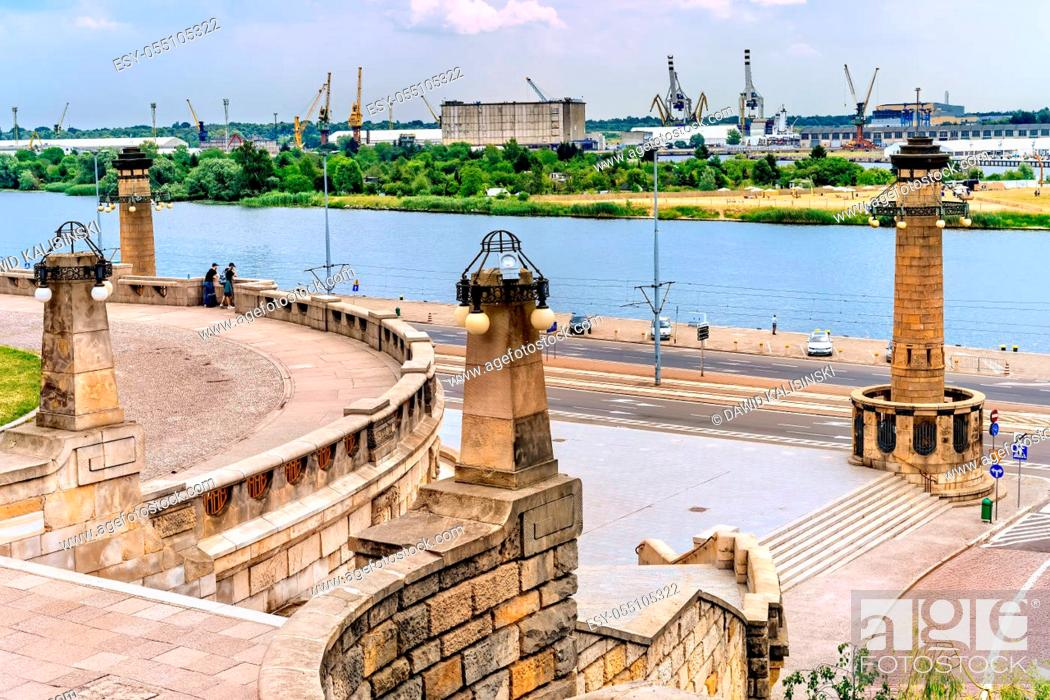 Stock Photo: View from Rampart of Brave and promenade on Old Town quay in Szczecin docklands with Odra River, rustic dock cranes and harbour in background.