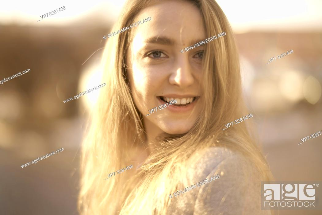 Stock Photo: young woman outdoors in sunlight, in Cottbus, Brandenburg, Germany.