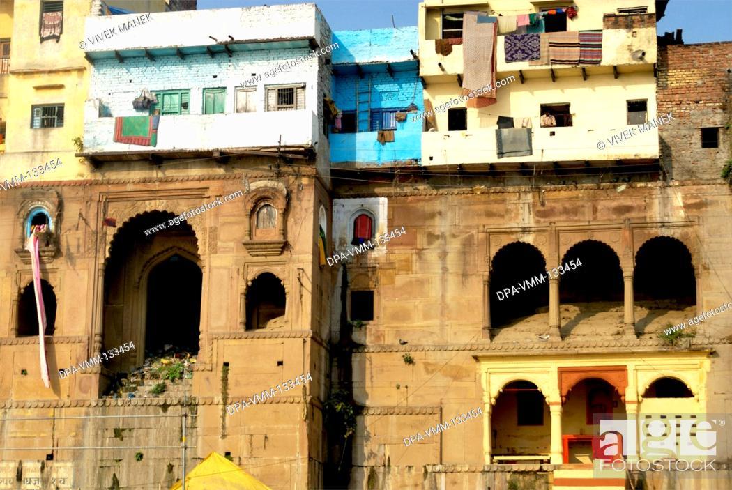 Stock Photo: Houses on ghat of holy Ganga river ; Varanasi ; Uttar Pradesh ; India.
