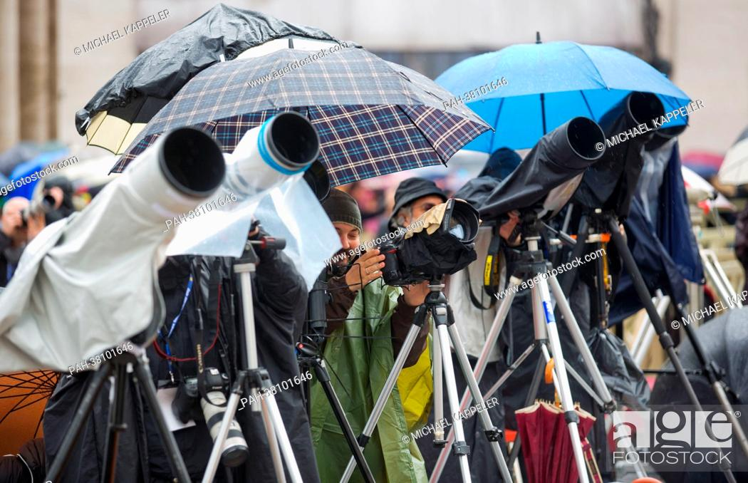 Stock Photo: Journalists wait for a smoke signal at the entrance of the Cardinals into the Sistine Chapel on St. Peter's Square in Vatican City, Vatican, 13 March 2013.