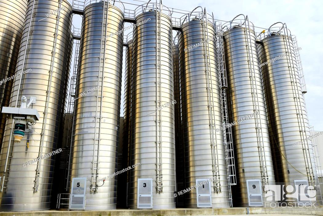 Photo de stock: Large stainless steel tanks containing plastic ingredients for extrusion industry.