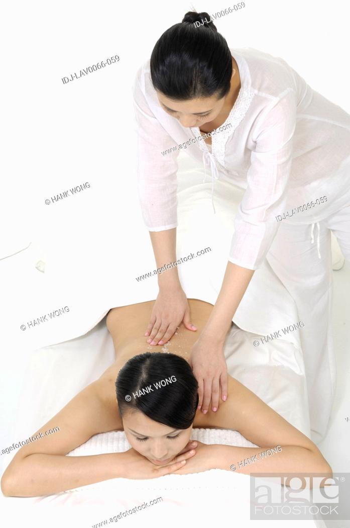 Stock Photo: Close-up of a woman getting back massage.