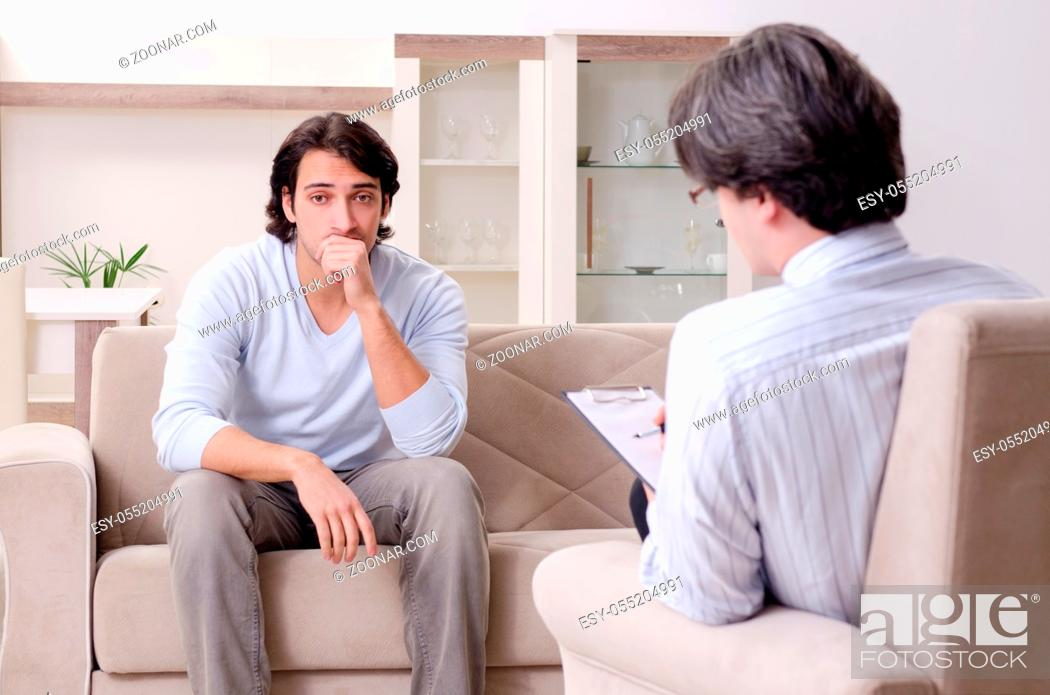 Stock Photo: Young male patient discussing with psychologist personal problems.
