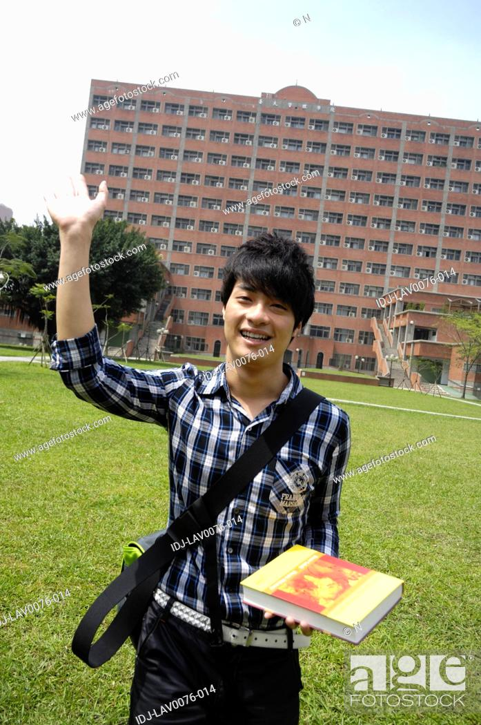 Stock Photo: Male university student waving his hand and smiling.