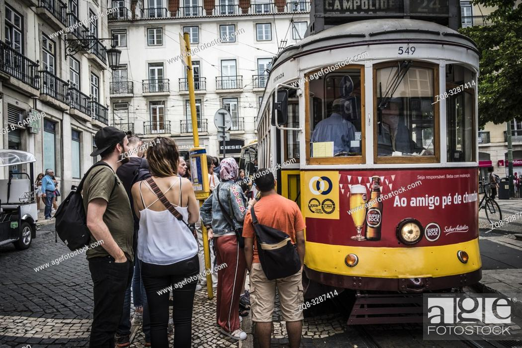 Stock Photo: Famous retro yellow tram on the street in Lisbon city, Portugal.