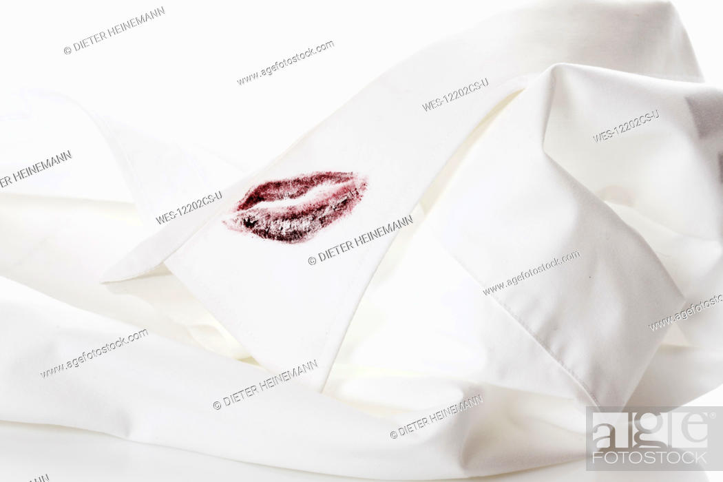 Stock Photo: Shirt collar with lipstick mark.