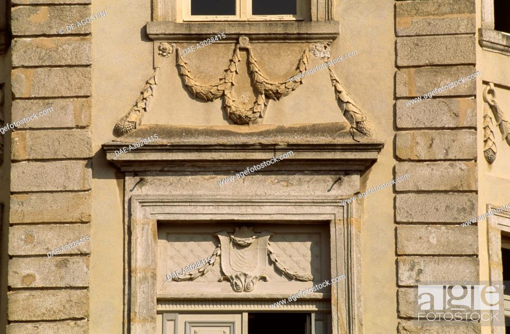 Stock Photo: Windows decoration on the facade of the Chabert castle or Chateau de Boen, 18th century, now the Museum of Forez winemakers, Boen-sur-Lignon, Rhone-Alpes.