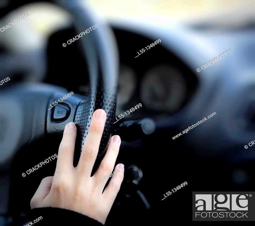 Stock Photo: Girl driving a car.