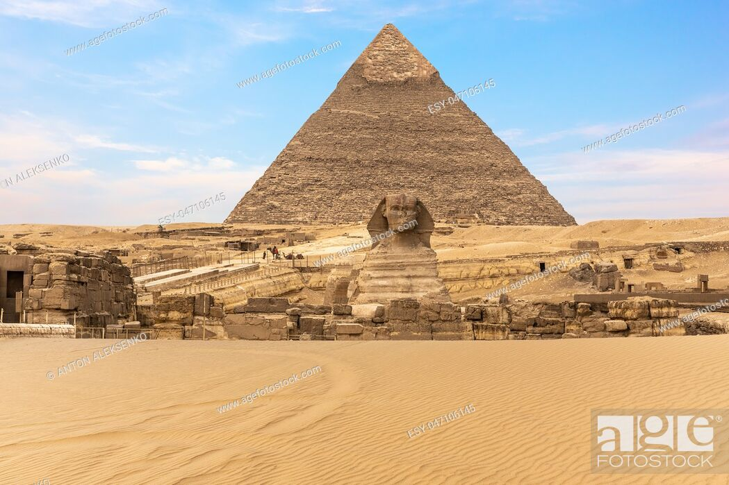 Stock Photo: The Great Sphinx of Giza in front of the Pyramid of Khafre, Egypt.