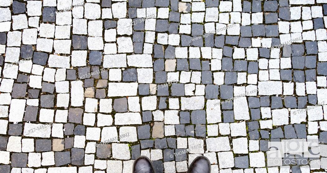 Stock Photo: Looking at Black and white cobblestone pattern.