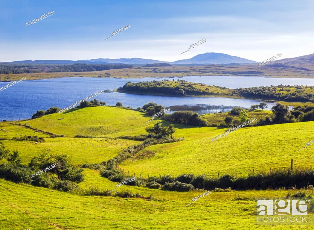 Photo de stock: Countryside leading down to Lough Corrib, Connemara, County Galway, Republic of Ireland. Eire. Lough Corrib is the largest lake in the Irish Republic.