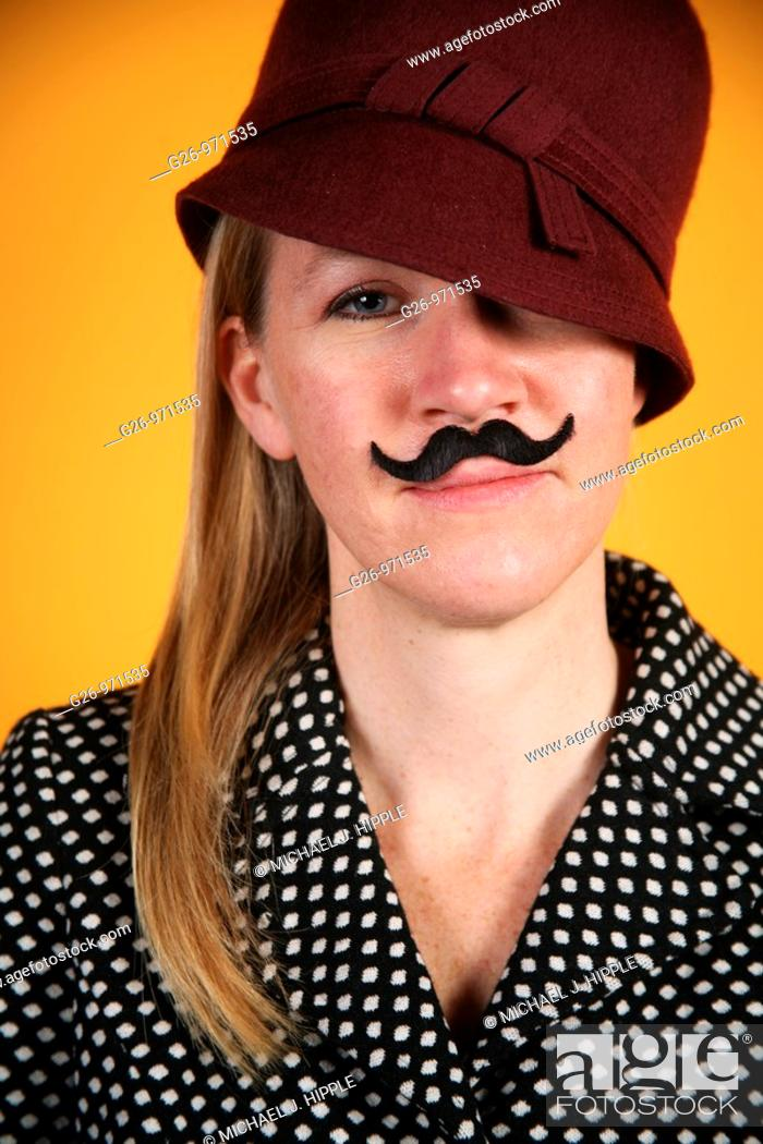 Stock Photo: Woman wearing fake moustache.