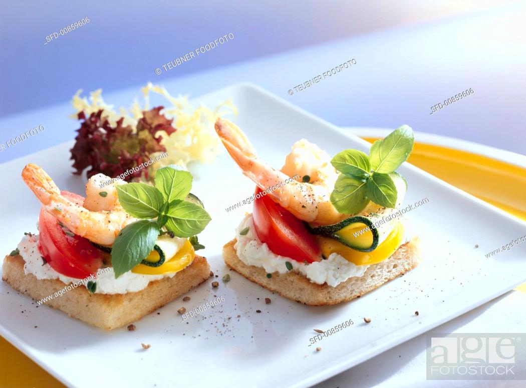 Photo de stock: Two shrimp canapés.