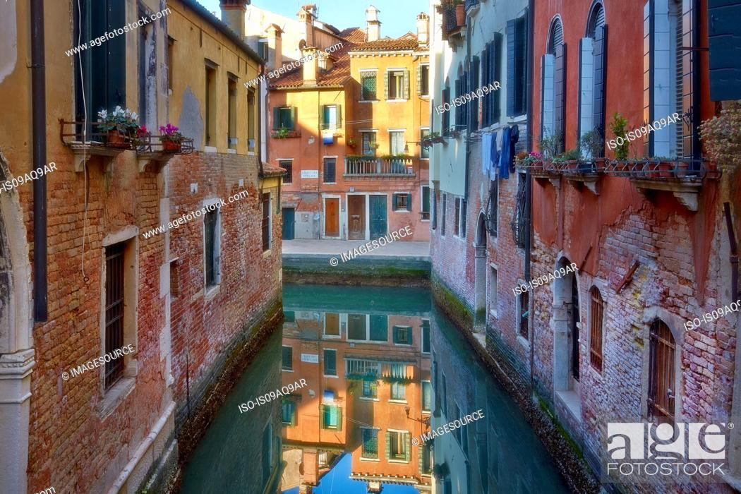 Stock Photo: Canal view and town houses at sunrise, Venice, Veneto, Italy.
