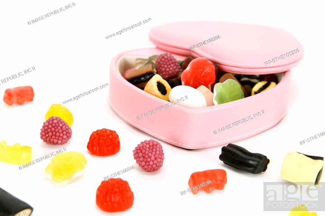 Stock Photo: jellies in the heart shaped box.