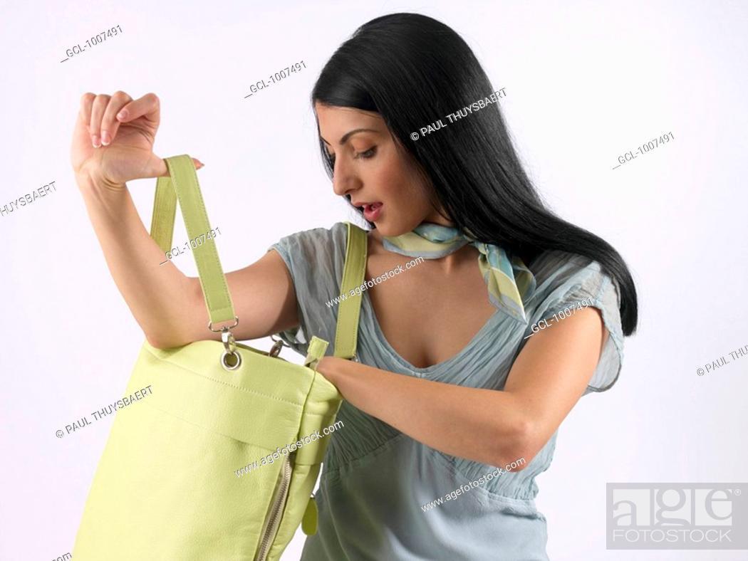 Stock Photo: Woman carrying handbag.