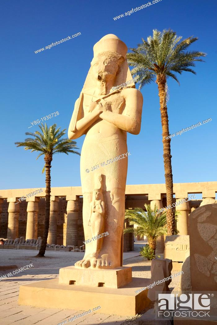 Stock Photo: Karnak, Egypt - Statue of Pharaoh Ramses II with Queen Nefertari in the Great Courtyard, Amun-Re Temple, Karnak temple complex, Upper Egypt, UNESCO.