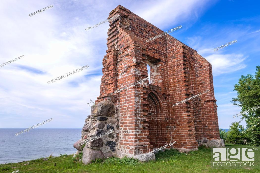 Stock Photo: Ruins of old church on a Baltic Sea beach in Trzesacz village, West Pomeranian Voivodeship of Poland.