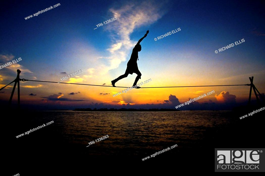 Stock Photo: Tightrope walker Key West Mallory Square.