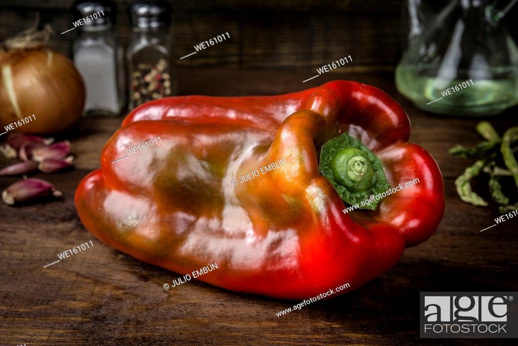 Photo de stock: red pepper illuminated in studio on classic rustic wooden board.