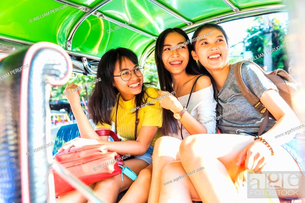 Stock Photo: Friends sightseeing in tuk tuk car, Bangkok, Thailand.