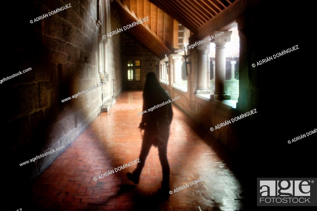 Stock Photo: View throw a window of a person walk into a monastery in Portugal.