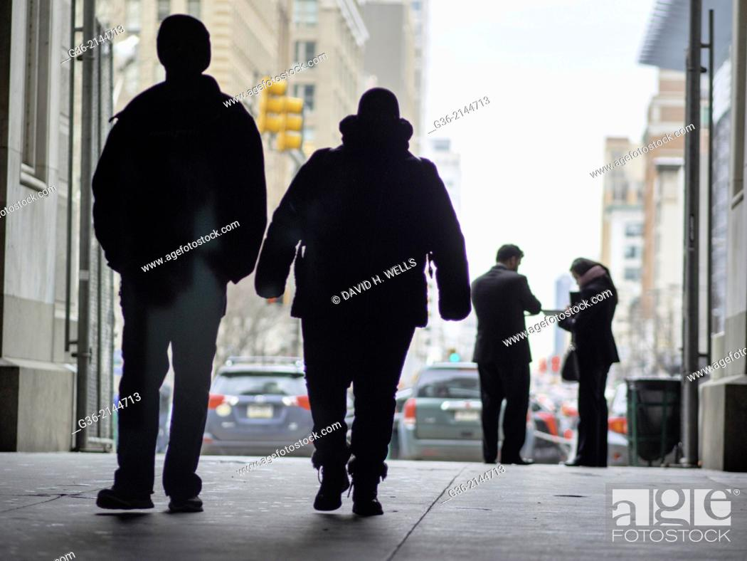 Stock Photo: Silhouette of pedestrian and city buildings in Philadelphia, Pennsylvania, United States.
