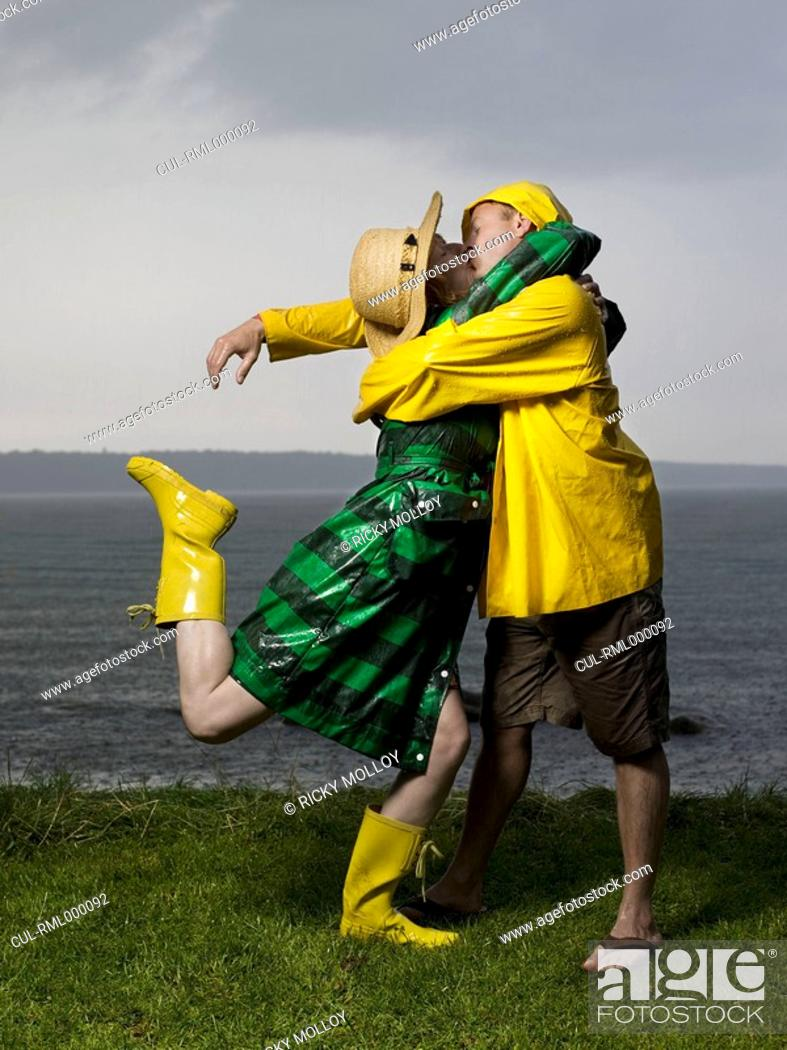 Stock Photo: Couple kissing and hugging in the rain.