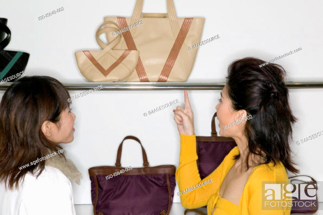 Stock Photo: Women shopping for handbags.