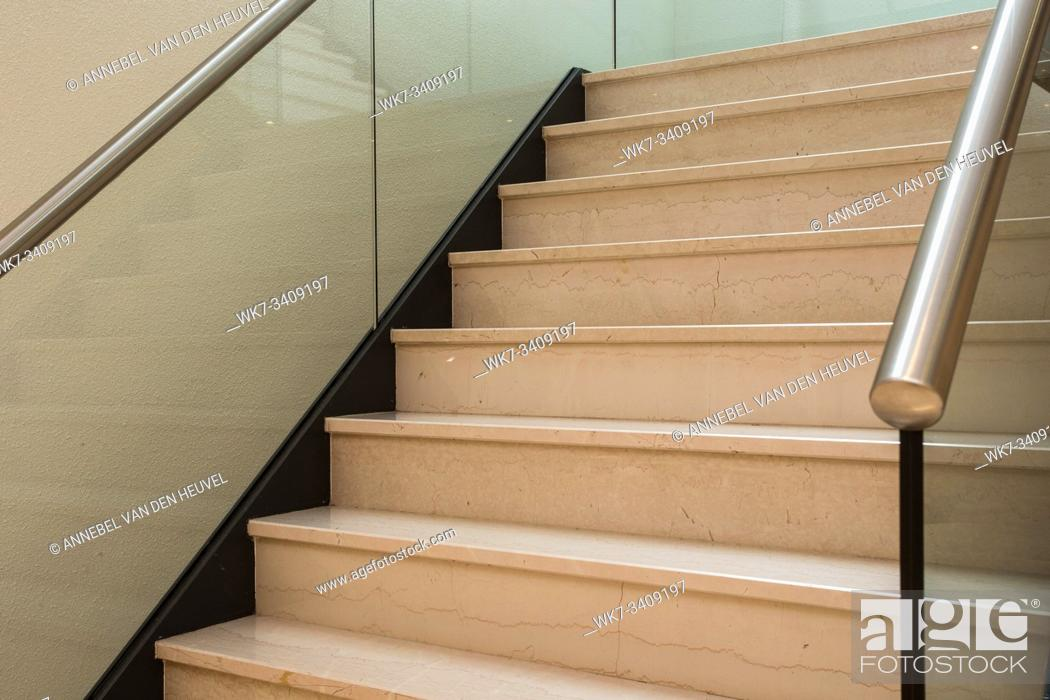 Stock Photo: Close up and details of railing and stairs of a modern building with glass.