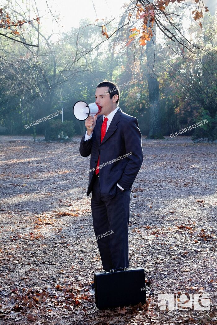 Stock Photo: Businessman speaking into a megaphone.