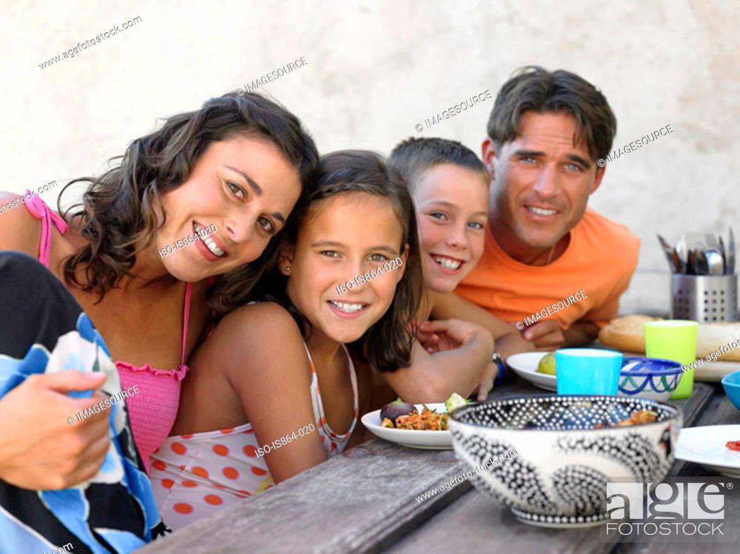 Stock Photo: Family at picnic table.