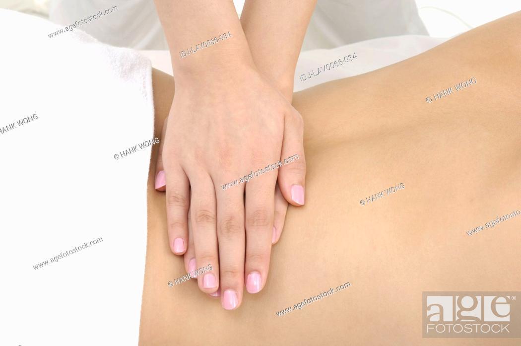 Stock Photo: Woman getting back massage.