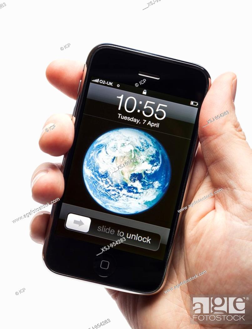 Stock Photo: Male hand holding apple iPhone showing start screen.