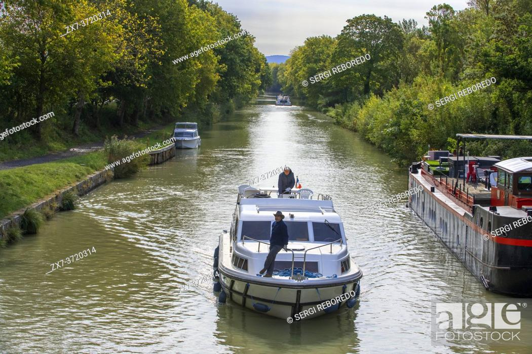Stock Photo: The Canal du Midi, near Carcassonne, French department of Aude, Occitanie Region, Languedoc-Rousillon France. Boats moored on the tree lined canal.