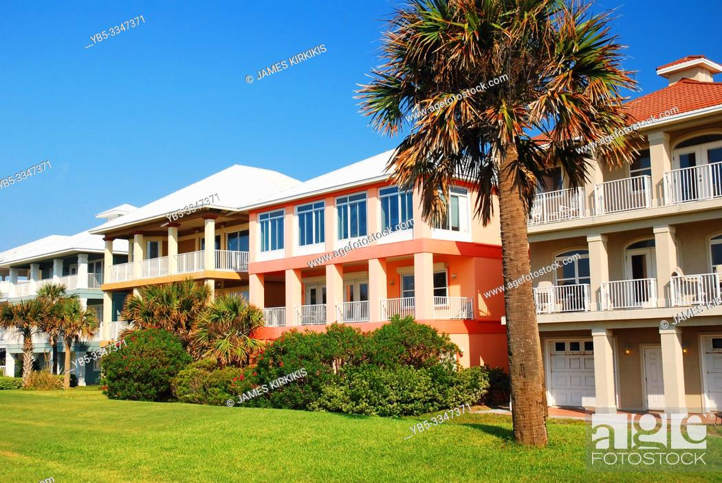 Stock Photo: Residential buildings painted in bright pastel colors on Floridaâ. . s Gulf Coast.