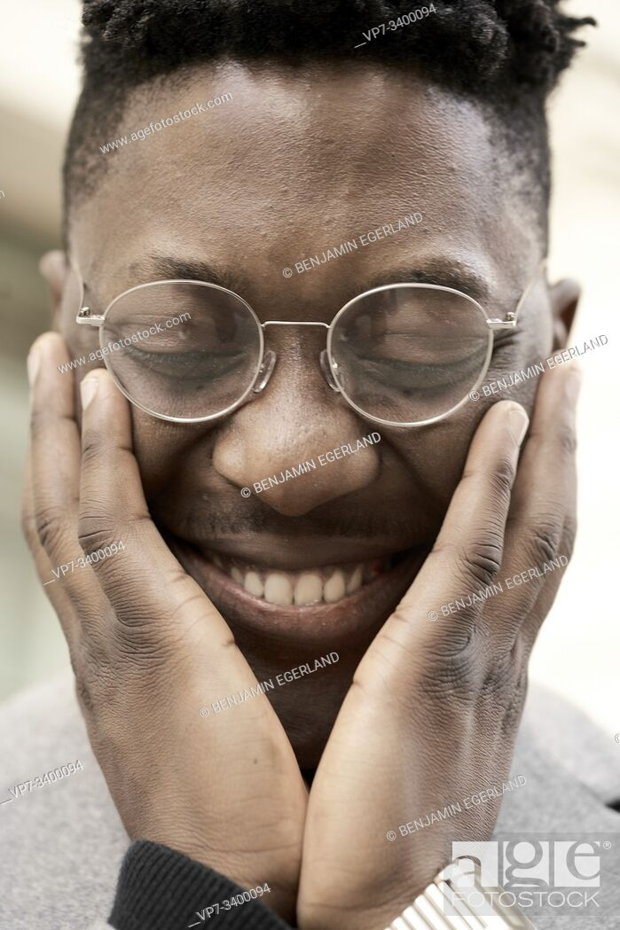 Stock Photo: happy African man giggling.